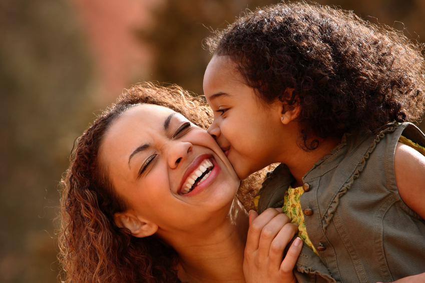 child therapy image, little girl kisses mother