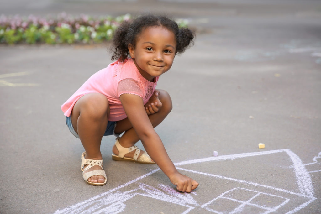 child therapy image, girl playing with chalk