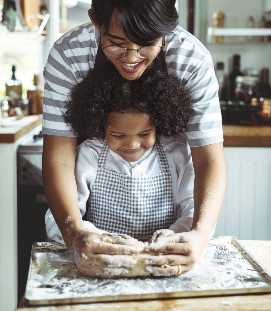 Family First VA homepage photo: Parent teaching child to bake