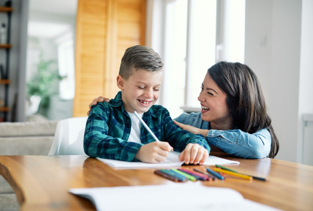Family First VA psychological testing image: mother and son with homework
