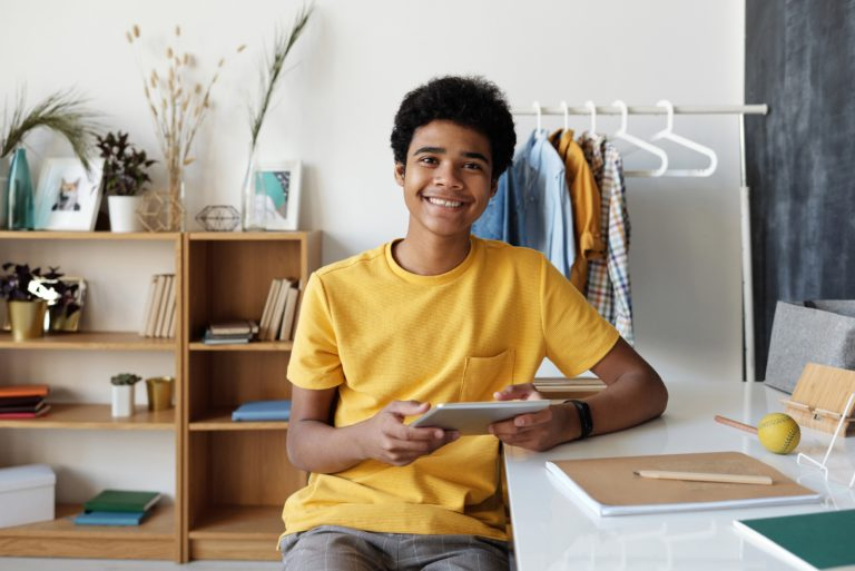 teen therapy image, teen boy holding tablet